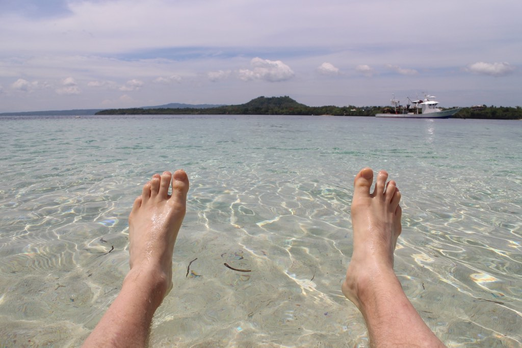 dipping my toes in the water on a philippine island near davao