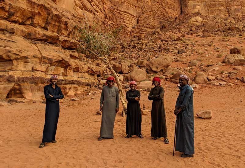 Local Bedouin guides in Wadi Rum smiling for the camera