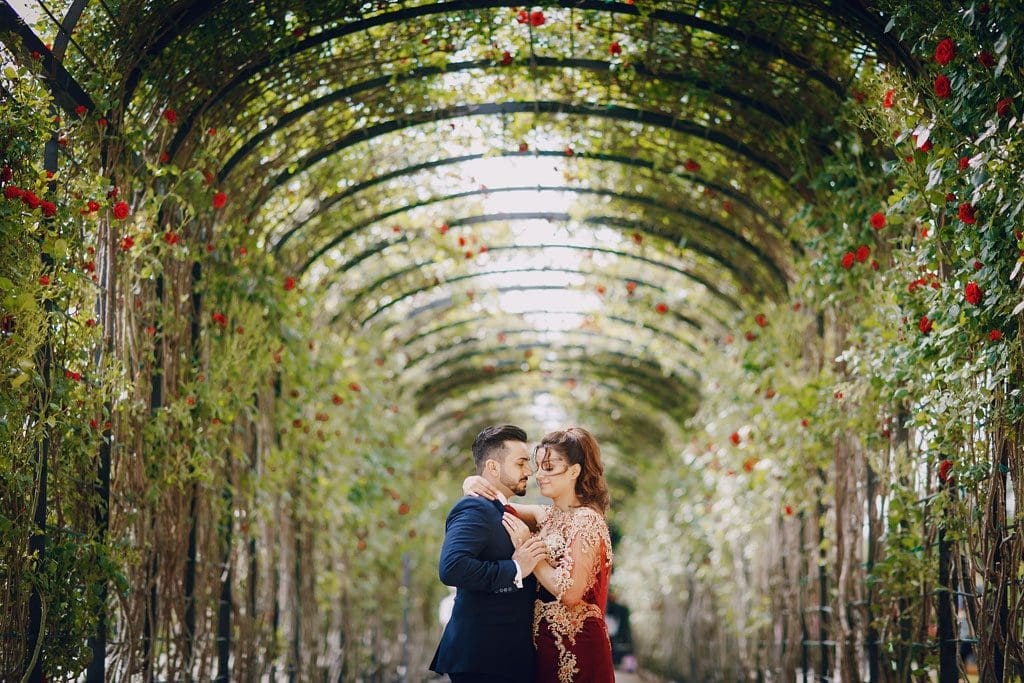 Turkish wedding couple beneath pergola
