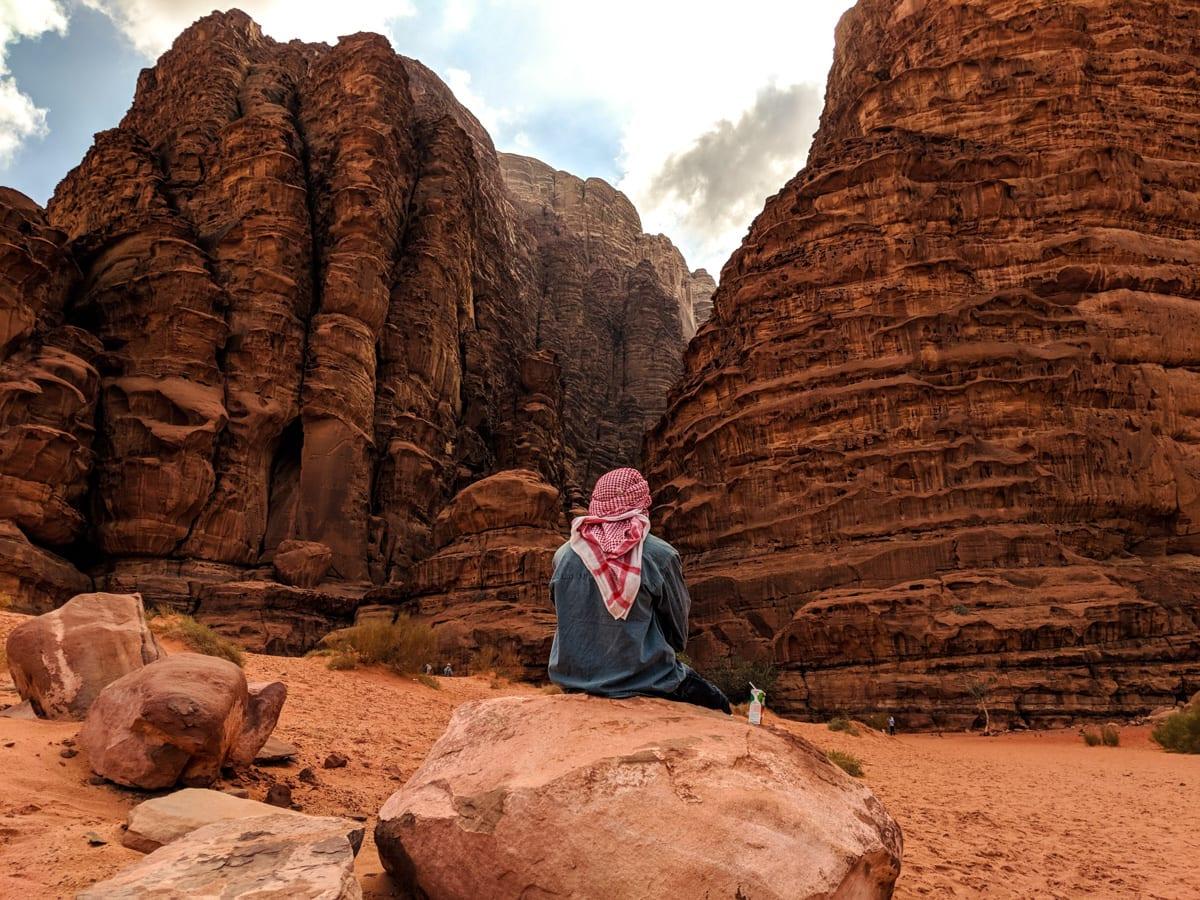 Bedouin sitting at entrance to Khazali canyon