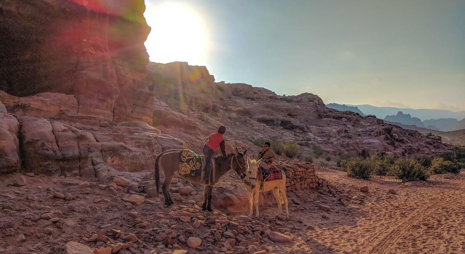 Local kids on horseback near the climb to the cathedral of petra