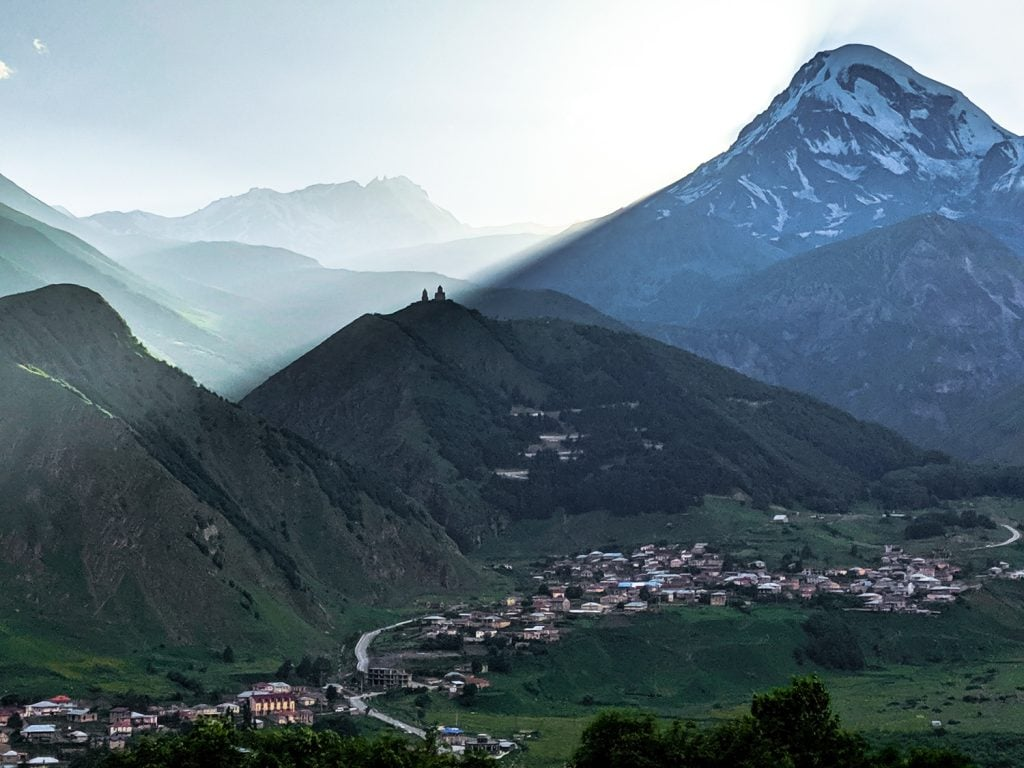 Image of The Gergeti Trinity Church in the shadow of Mount Kazbek