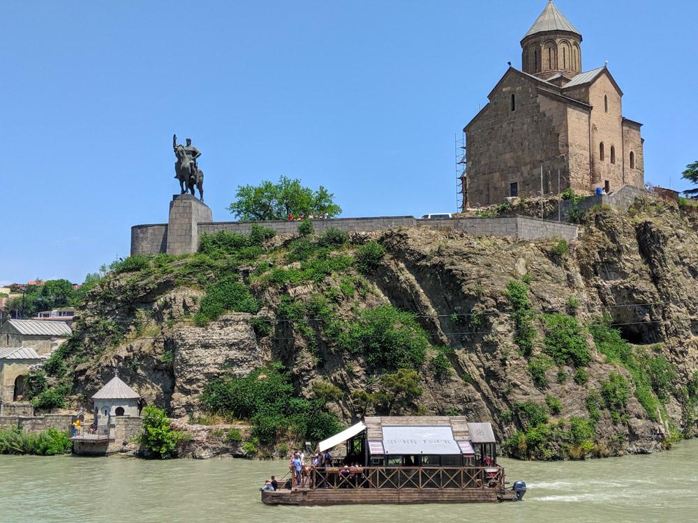 Atatue of king Vakhtang Gotgasali Mtkvari river and Metekhi st virgin church