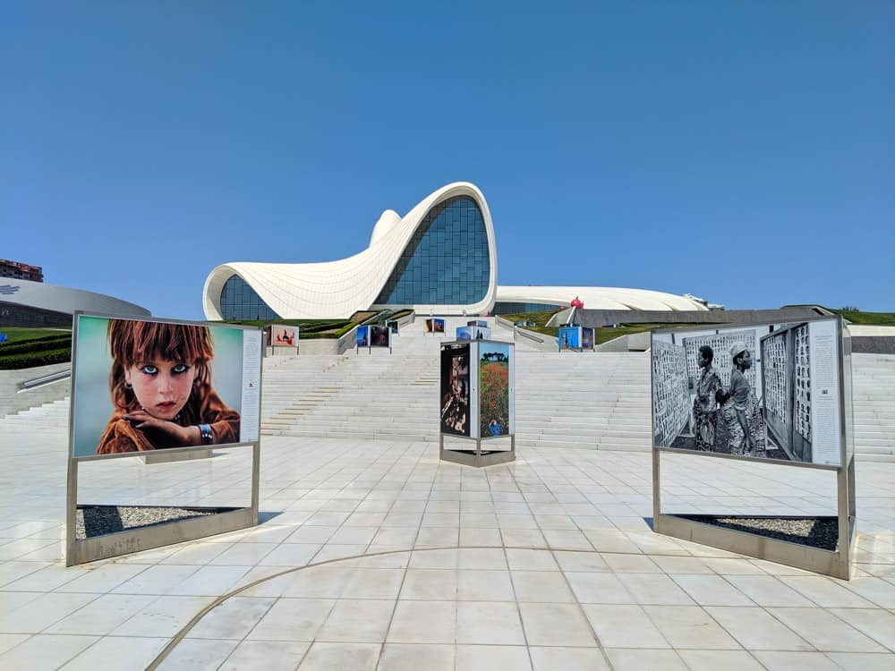 heydar aliyev center  with posters.